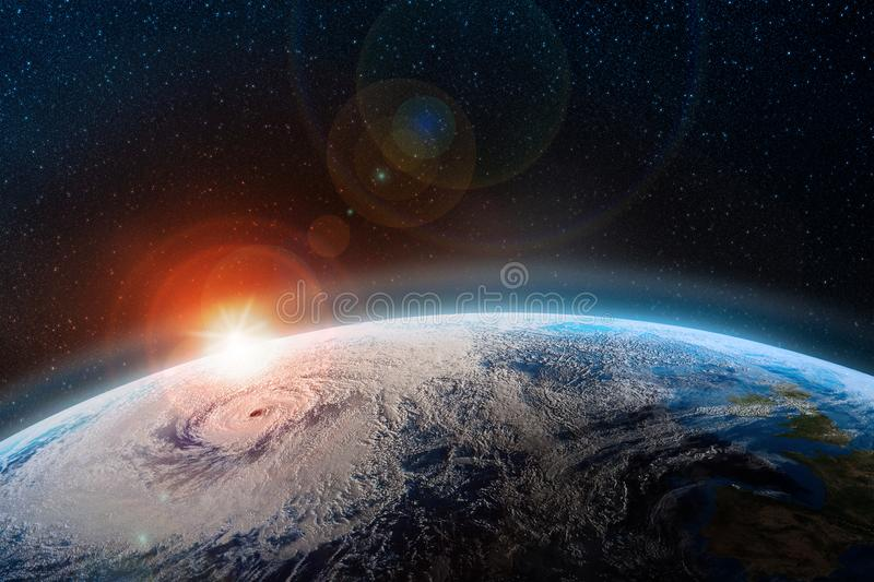 Dawn over the planet. A view from outer space to the surface of the Earth. Hurricane over the ocean. Elements of this image furnished by NASA stock illustration