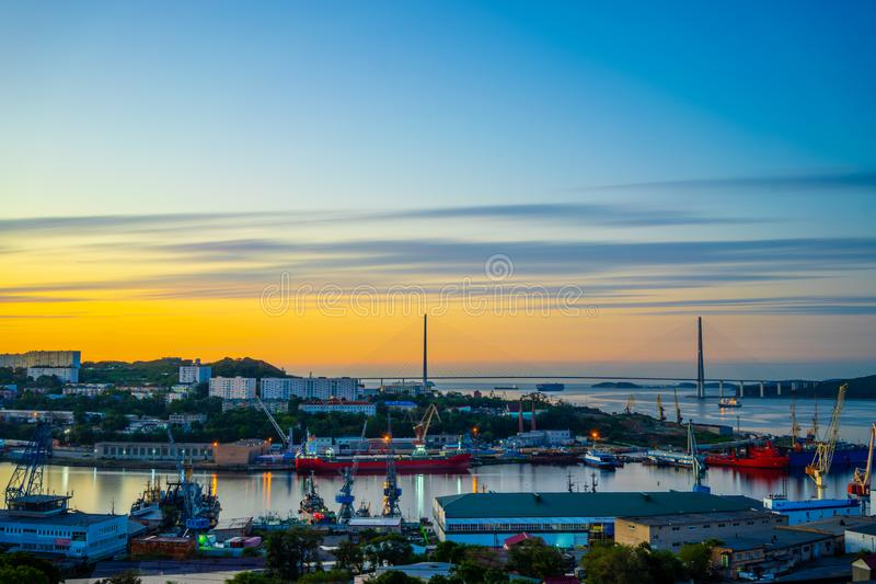Dawn over the sea Bay overlooking the Russian bridge royalty free stock photography