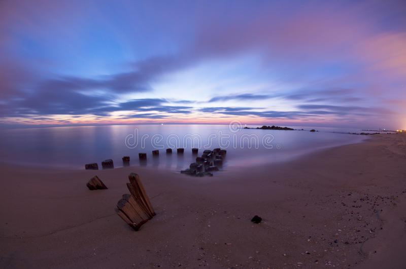 Download Dawn pilings stock photo. Image of vertical, color, vibrant - 13315700