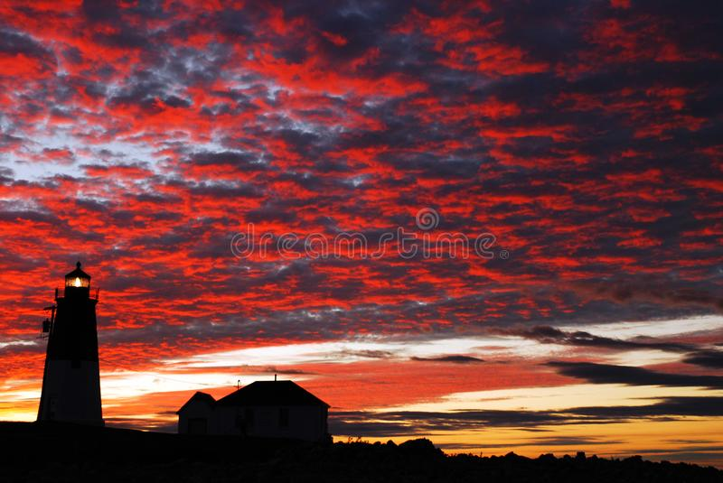 Dawn, Point Judith Lighthosue. Clouds glow above the Point Judith Lighthouse at Dawn royalty free stock photo