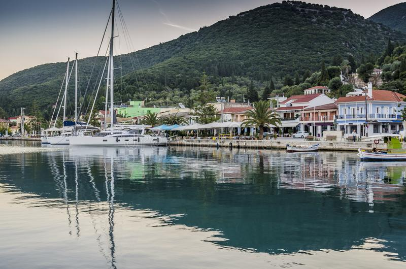 Dawn in the port of Sami on the island of Kefalonia Greece. Moored sailboats and facilities of Sami harbor on an October sunrise on the island of Kefalonia over stock photo