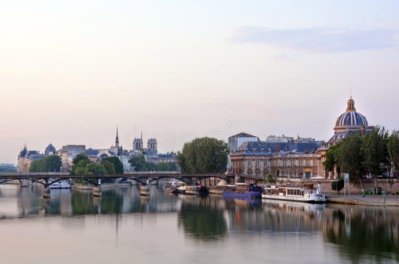 Dawn reflection on Seine River & Pont Neuf, Paris France. stock images