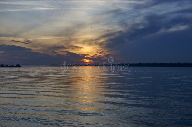 Dawn on the river. Solar track. stock photos