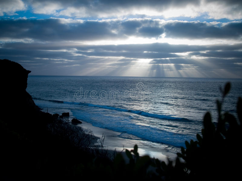 Dawn's light on the ocean stock images