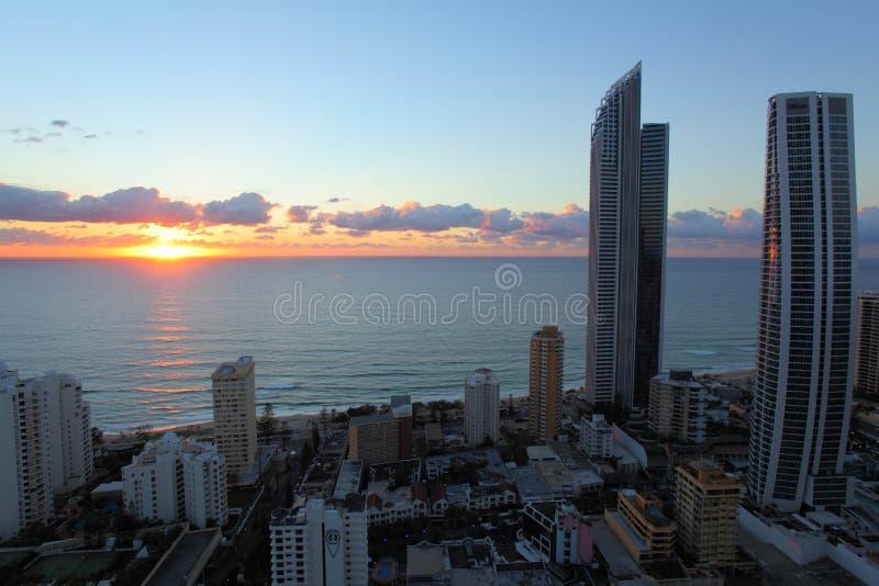 Ocean sunrise coastal living at top floor in city royalty free stock photos