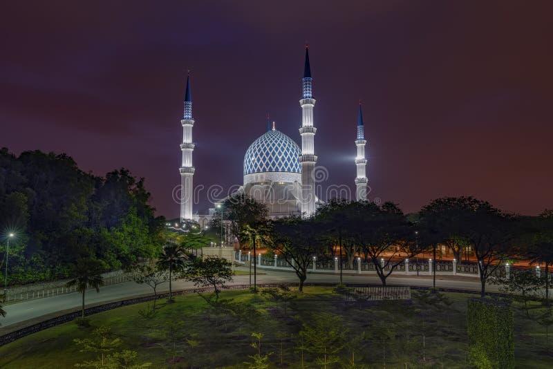 Dawn at Shah Alam Mosque. Shah Alam, MALAYSIA - February 18, 2018: Cloudy sunrise at the Shah Alam Mosque. Also known as the Sultan Salahuddin Abdul Aziz Shah stock photo