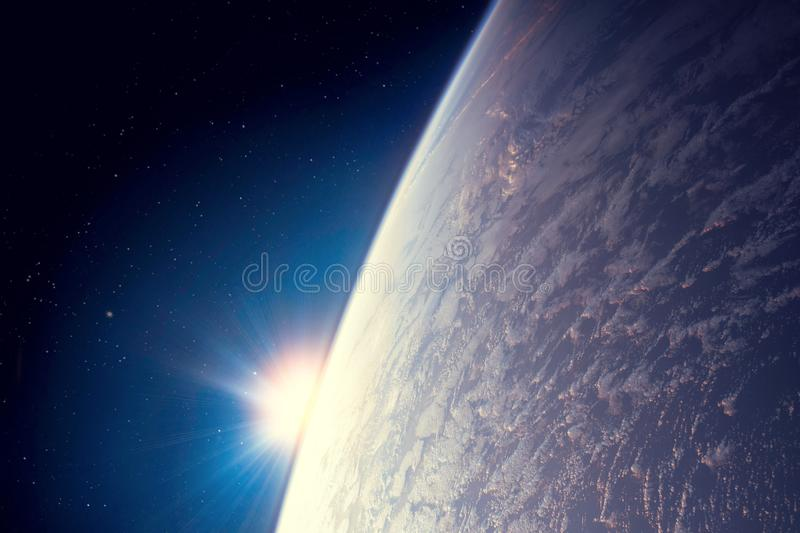 Dawn of the sun over planet Earth, a bright flash of stars and rays. Elements of this image furnished by NASA royalty free illustration