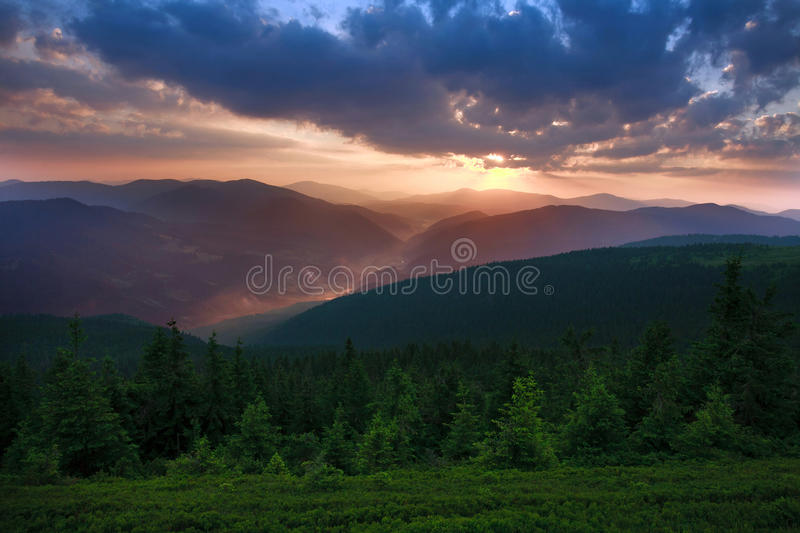 Dawn sun rise early morning with gray clouds in mountain valley stock photography