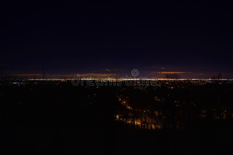 Dawn, with trees, stars, planets, NJ NY New York City New Jersey wide. Blue sky, presunrise. Timed exposure in total darkness. Shows Manhattan, Bronx, NY, and royalty free stock images