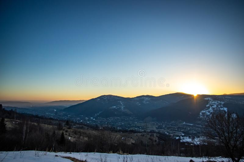 Dawn in the winter in the mountain town. Dawn in the winter in a mountain town in the Carpathians royalty free stock images