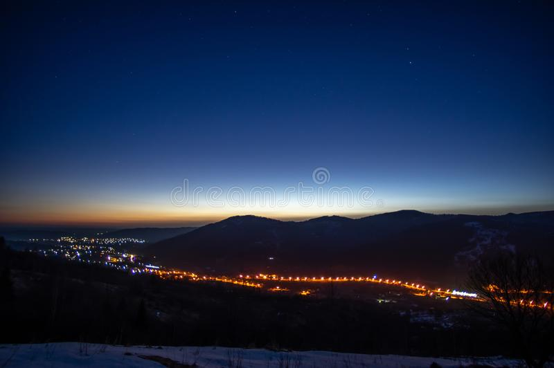 Dawn in the winter in a mountain town. In the Carpathians stock photos