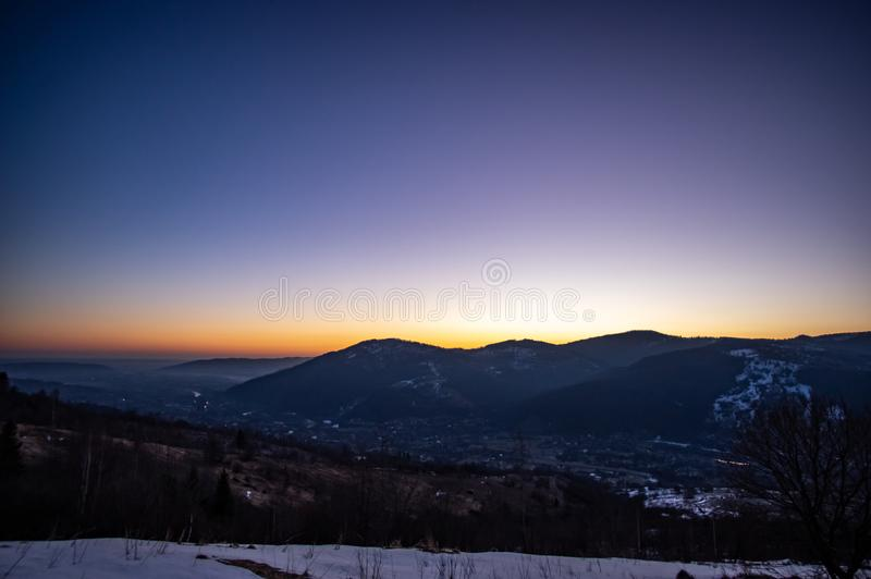 Dawn in the winter in the mountain town. Dawn in the winter in a mountain town in the Carpathians stock photos