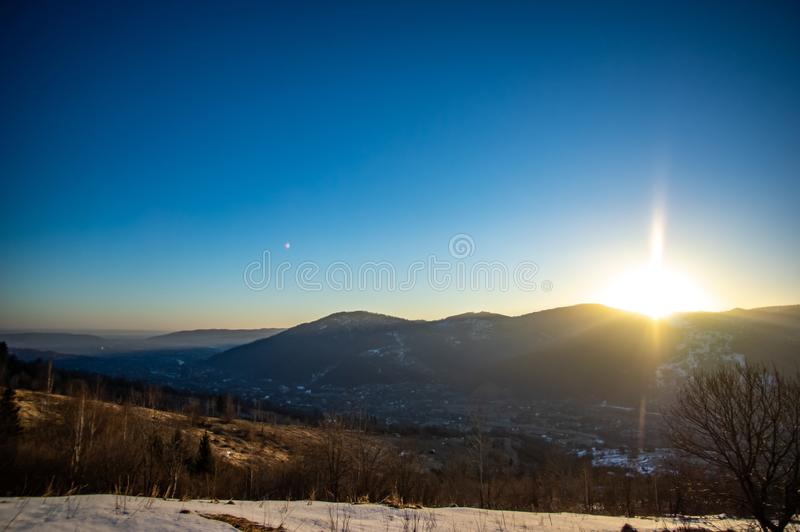 Dawn in the winter in the mountain town. Dawn in the winter in a mountain town in the Carpathians stock image
