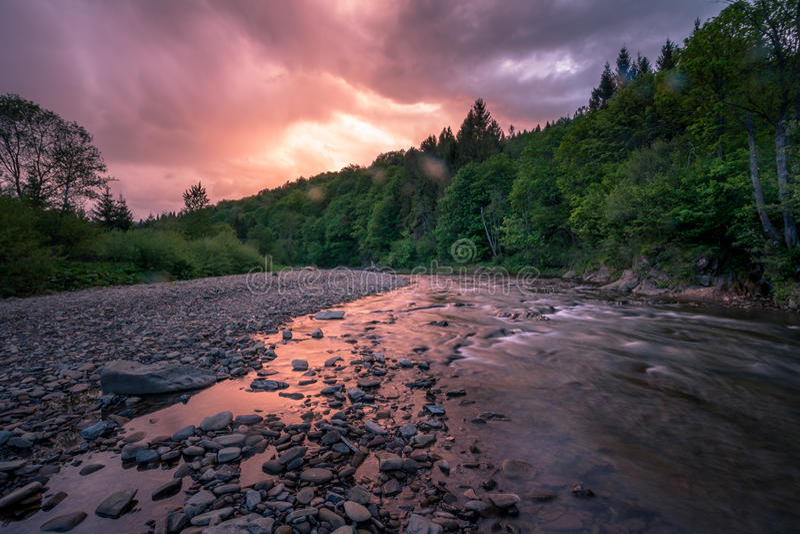 Dawning on mountain river. Wolosaty river in The Bieszczady Mountains at sunset. Photo taken near Ustrzyki Gorne village stock image