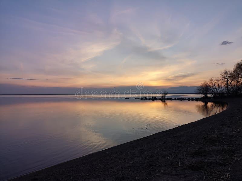 Dawning sun lake. Nature beauty water sand sky stock photos