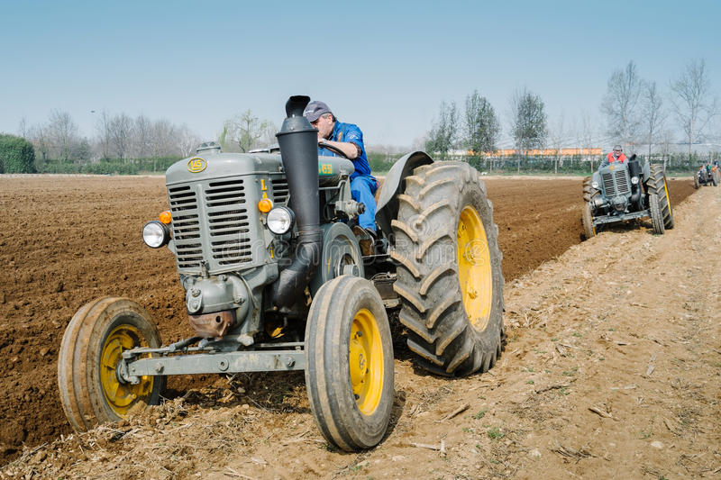 Day annual plowing with vintage tractors. VICENZA, ITALY - MARCH 20, 2016: Day annual plowing with antique tractors `Rosa` in Vicenza, Italy royalty free stock photo