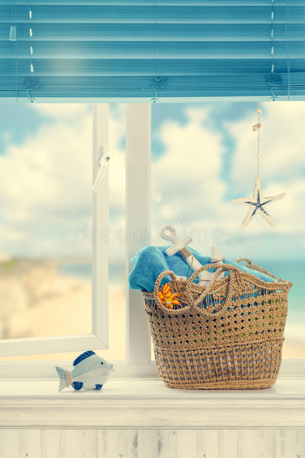A Day At The Beach. Beach basket packed ready for a day out royalty free stock photo