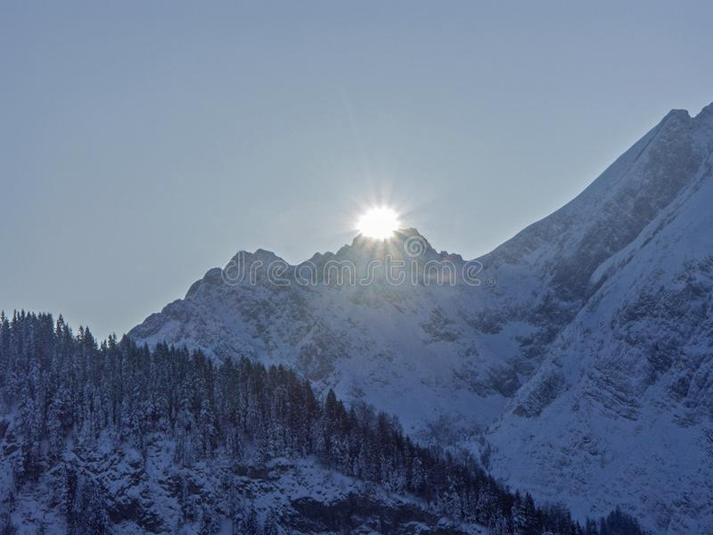 The day begins in Tyrol. Sunrise in the Karwendel mountains in mid-winter stock image
