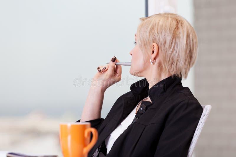 Day break. Business woman having short break during work royalty free stock photo
