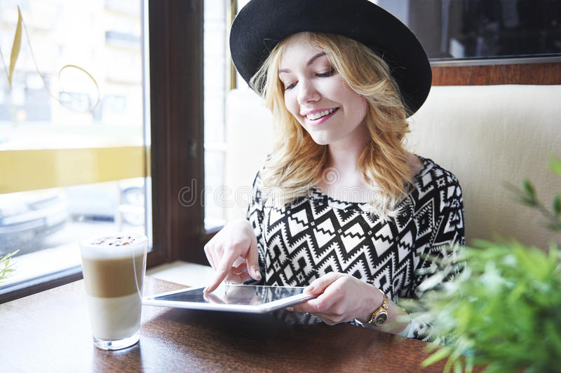 Day at cafe. New technology is necessary in contemporary life stock photography