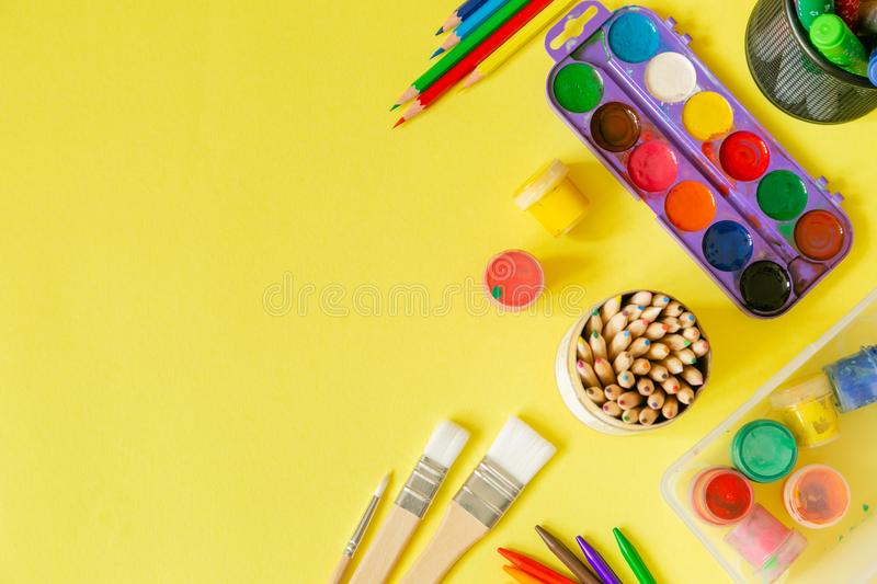Day care concept - art supplies and toys on bright background stock photo