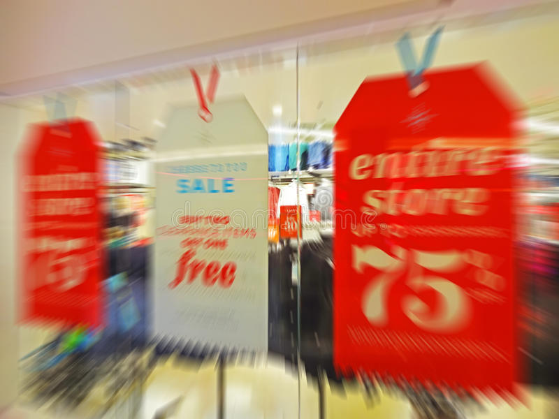 Day After Christmas Bargains. Photo of sale signs at a shopping mall the day after christmas with discounts up to 75% off. Sometimes waiting two days can allow stock image