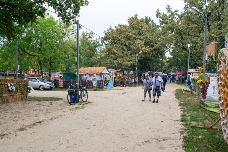 Day of the city of Slavyansk-on-Kuban, folk festivities in the city park. Representation of rural settlements in national traditio stock photos