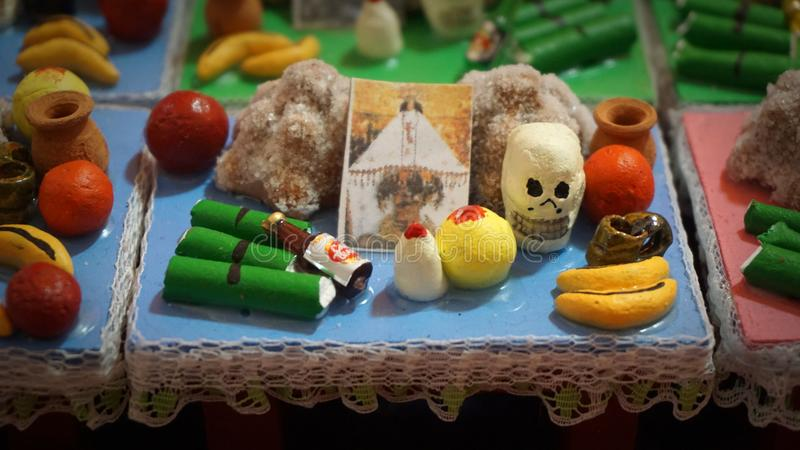Day of the dead altar. Tiny altar made of miniature items as fruits or food, traditional item used in the mexican day of the dead celebration to share with the royalty free stock image
