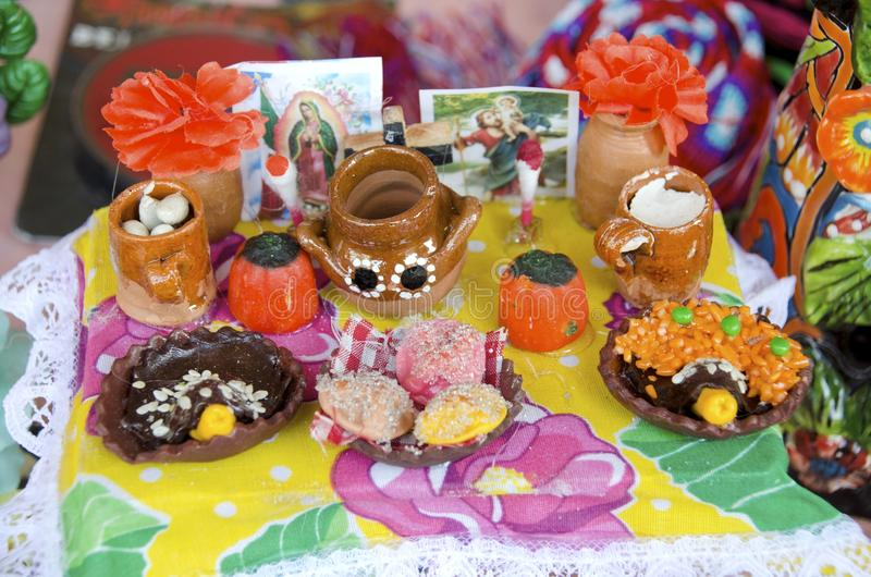 Day of the Dead. A miniature altar with offerings of food to remember ancestors on the mexican day of the dead or die de muertos holiday stock photography
