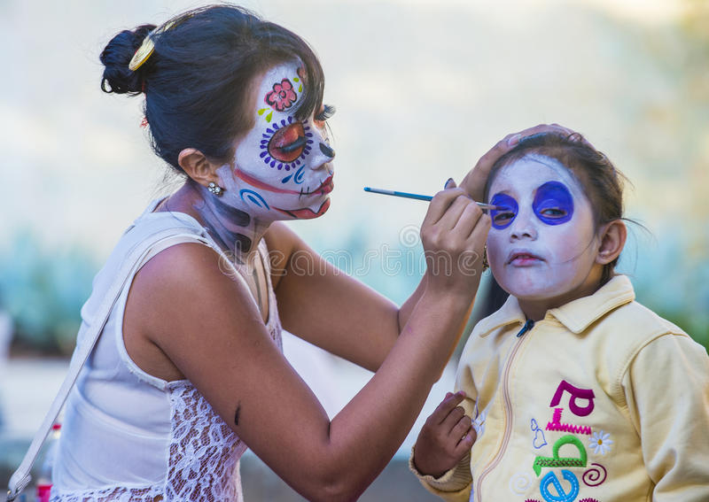 Day of the Dead. OAXACA , MEXICO - NOV 02 : Unidentified participant has his face covered with makeup on a carnival of the Day of the Dead in Oaxaca, Mexico on stock photos