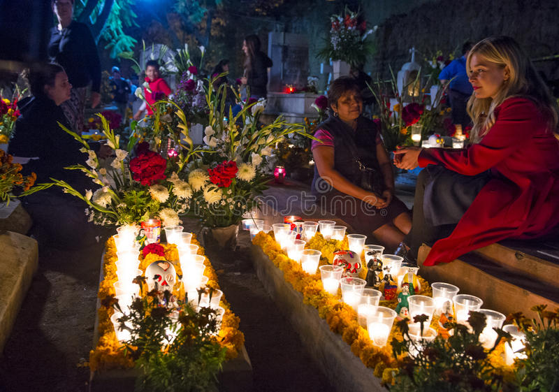 Day of the Dead. OAXACA , MEXICO - NOV 02 : Unidentified people on a cemetery during Day of the Dead in Oaxaca, Mexico on November 02 2015. The Day of the Dead stock images