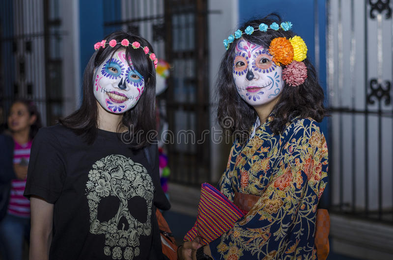oaxaca oaxaca mexico november 1 2016 japanese tourists painted like traditional mexican catrinas during day of the dead celebration in oaxaca mexico