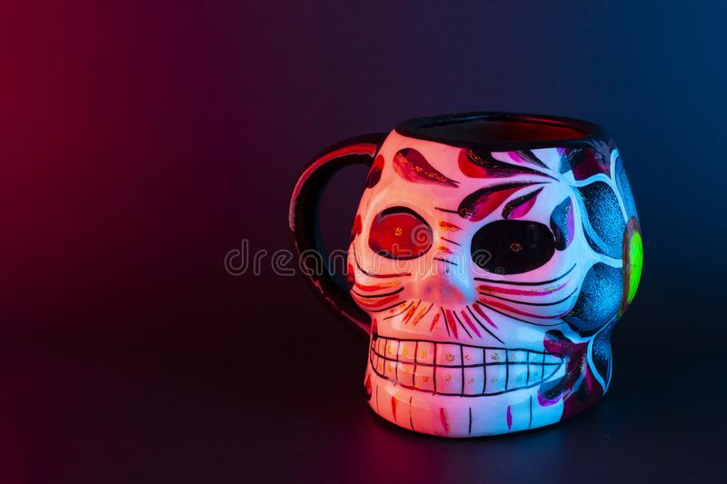 Day of the dead skull coffee mug. With colourful patterns royalty free stock photo