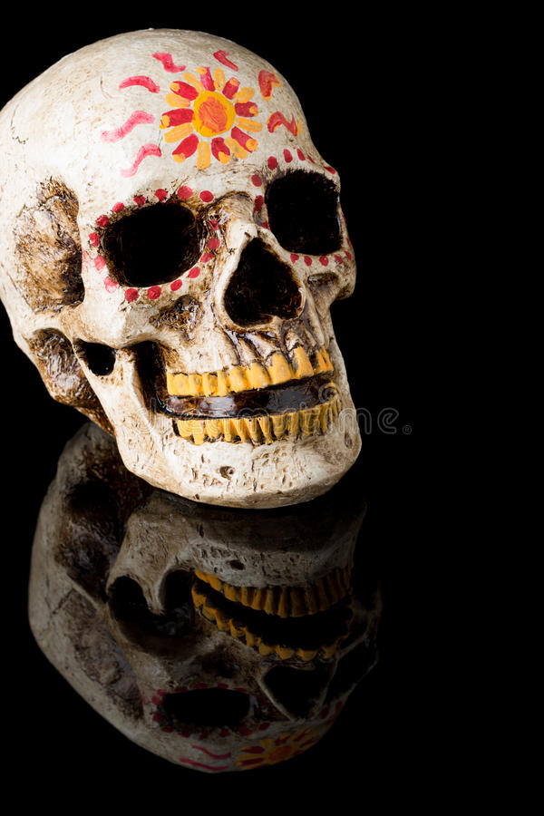 Day of The Dead Skull. Hand painted Dia de los Muertos (Day of The Dead) skull on black background royalty free stock image