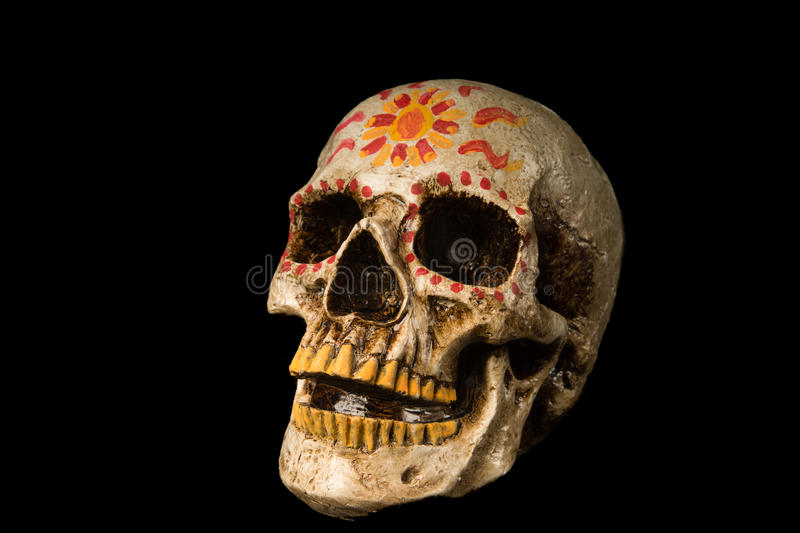 Day of The Dead Skull. Hand painted Dia de los Muertos (Day of The Dead) skull isolated on black background stock photo