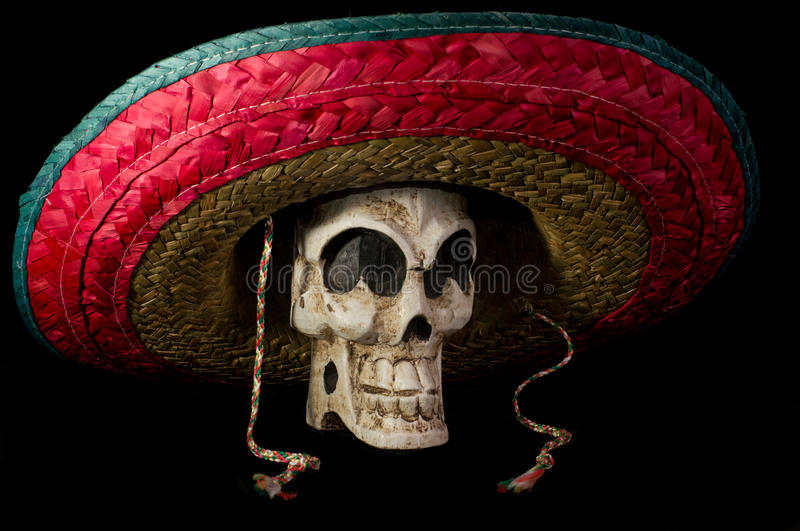 Day of The Dead Skull With Sombrero. Dia De Los Muertos (Day of the Dead) skull wearing colorful Mexican sombrero on isolated on black background stock photography