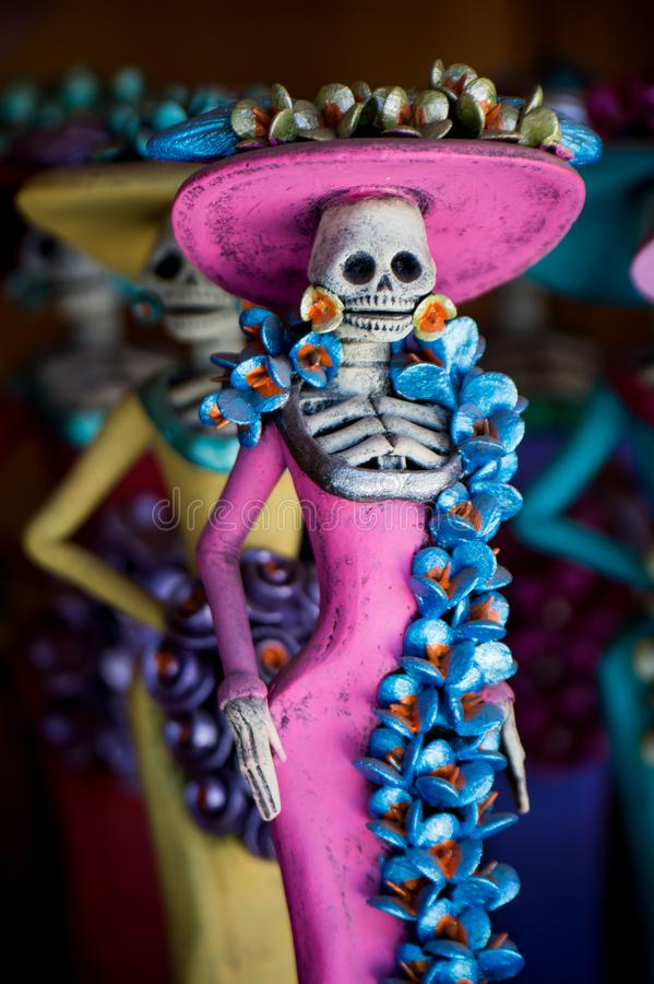 Day of the Dead. Statuette of a woman - female skeleton- with a pink dress. Day of the Dead, or Dia de los Muertos, is a holiday that has been celebrated on stock images