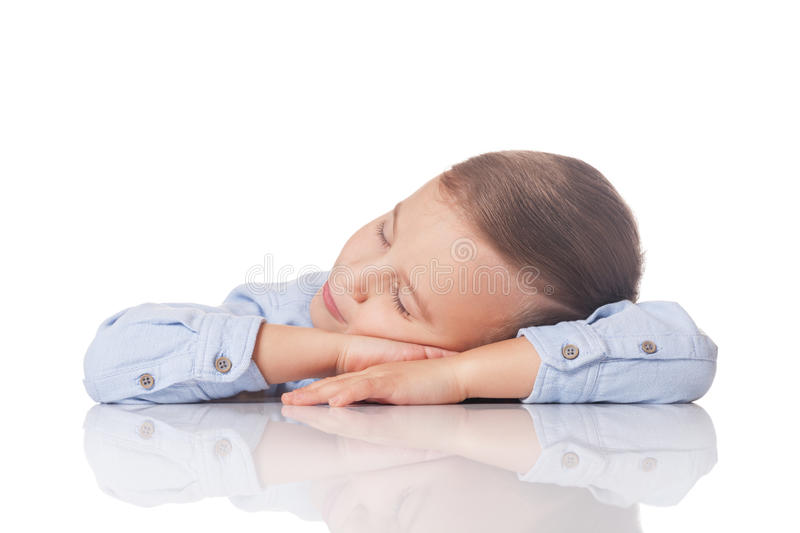 Day dreaming boy. Relaxed and positive boy having day dream on isolated white royalty free stock photography