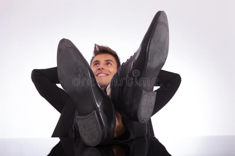 Day Dreaming With Legs On Desk Stock Photography
