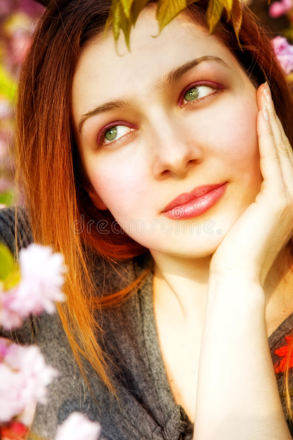 Download Day Dreaming Pensive Woman And Spring Flowers Stock Photo - Image: 9954732