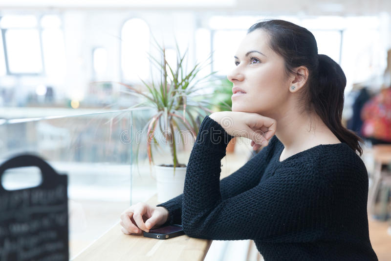 Day dreaming woman stock image