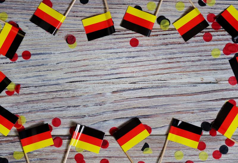 October 3, happy German independence Day. the concept of patriotism , freedom and independence. Mini paper flags with yellow and. Day of German Unity written in royalty free stock images