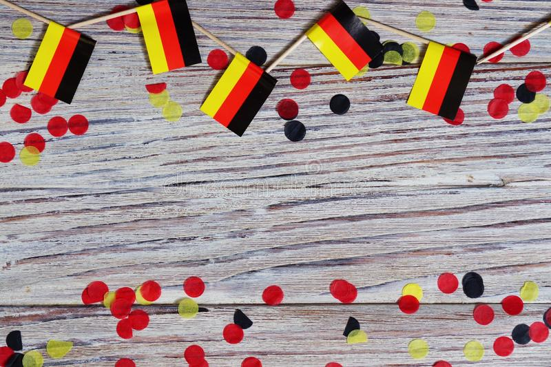 October 3, happy German independence Day. the concept of patriotism , freedom and independence. Mini paper flags with yellow and. Day of German Unity written in royalty free stock image