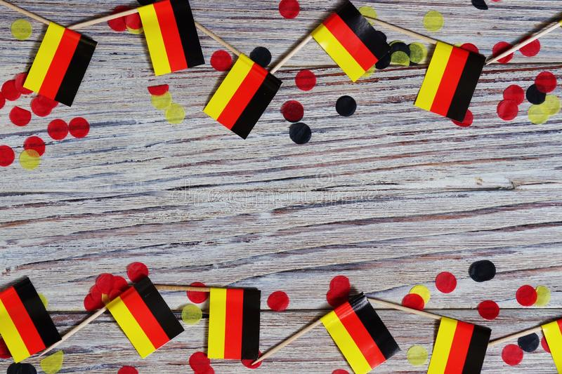 October 3, happy German independence Day. the concept of patriotism , freedom and independence. Mini paper flags with yellow and. Day of German Unity written in royalty free stock photo