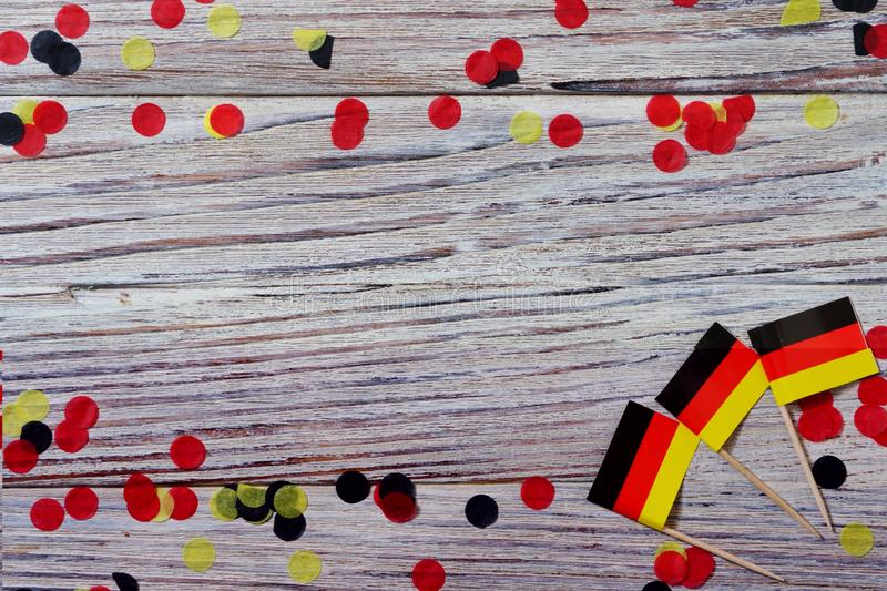 October 3, happy German independence Day. the concept of patriotism , freedom and independence. Mini paper flags with yellow and. Day of German Unity written in stock photography