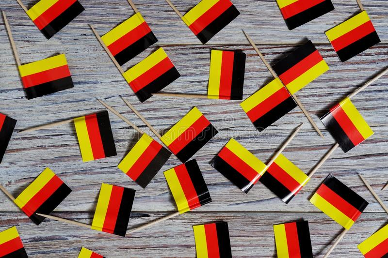 October 3, happy Day of German unity. the concept of patriotism , freedom and independence. Mini flags on wooden background. Day of German Unity written in royalty free stock photography
