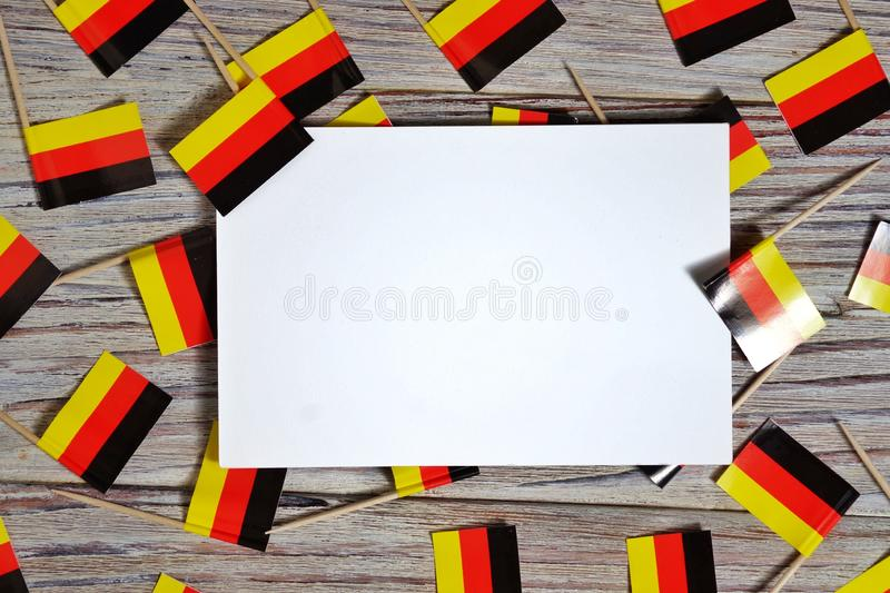 October 3, happy Day of German unity. the concept of patriotism , freedom and independence. Mini flags with a white card on wooden. Day of German Unity written royalty free stock photos