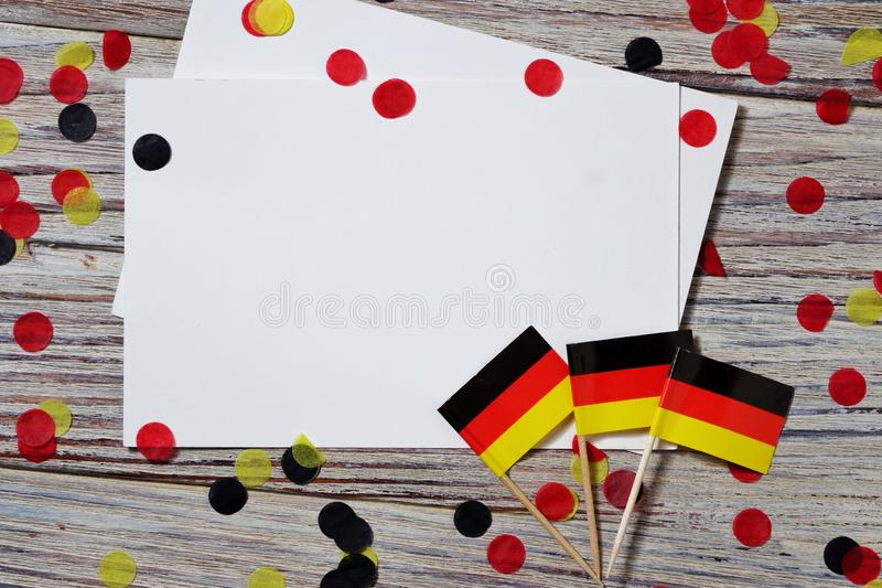 October 3, German unification Day. the concept of patriotism , freedom and independence. Mini paper flags with yellow and red. Day of German Unity written in stock photography