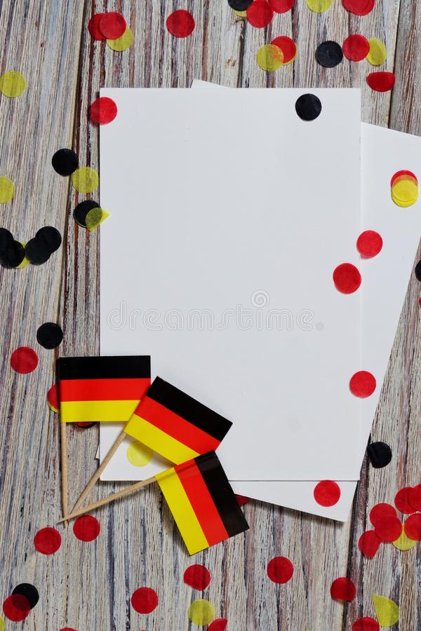 October 3, German unification Day. the concept of patriotism , freedom and independence. Mini paper flags with yellow and red. Day of German Unity written in royalty free stock photography