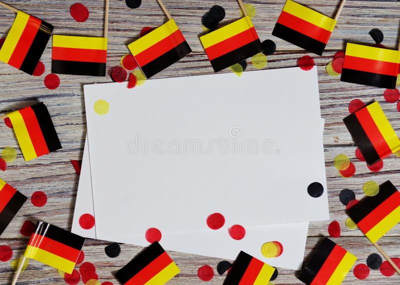 October 3, German unification Day. the concept of patriotism , freedom and independence. Mini paper flags with yellow and red. Day of German Unity written in stock image
